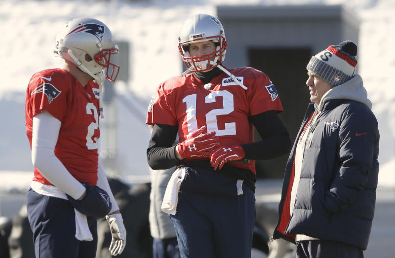 Tom Brady (12) wears gloves at practice Thursday after hurting his right hand on Wednesday. (AP)