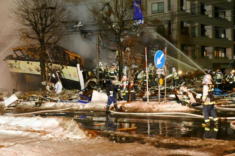 Firefighters work at the scene after an explosion at a restaurant in Sapporo, in the northern Hokkaido prefecture on December 16, 2018
