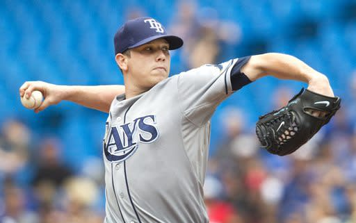 Tampa Bay Rays starting pitcher Jeremy Hellickson throws against the Toronto Blue Jays during the first inning of a baseball game in Toronto, Saturday, Aug. 23, 2014. (AP Photo/The Canadian Press, Fred Thornhill)