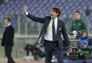 Lazio's head coach Simone Inzaghi gives instructions during a Champions League group F soccer match between Lazio and Zenit Saint Petersburg, at Rome's Olympic Stadium, Tuesday, Nov. 24, 2020. (AP Photo/Andrew Medichini)