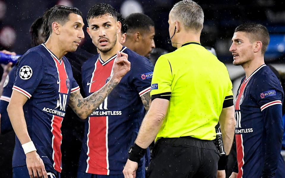 PSG's Angel Di Maria (L) reacts after receiving a red card from Dutch referee Bjorn Kuipers (2-R) during the UEFA Champions League semi final, second leg soccer match between Manchester City and Paris Saint-Germain in Manchester, Britain, 04 May 2021.  - PETER POWELL/EPA-EFE/Shutterstock
