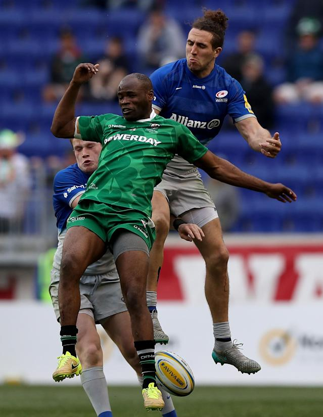 HARRISON, NJ - MARCH 12: Topsy Ojo #11 of London Irish fights for the ball with Nick Tompkins #13 and Mike Ellery #14 of Saracens during the Aviva Premiership match on March 12, 2016 at Red Bull Arena in Harrison, New Jersey. (Photo by Elsa/Getty Images)