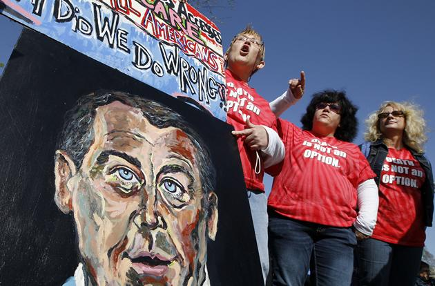 Supporters for the health care reform bill rally in front of the Supreme Court.