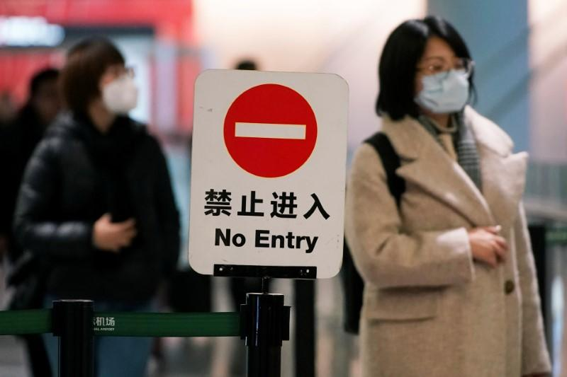 Passengers wearing masks are seen at Hongqiao International Airport in Shanghai