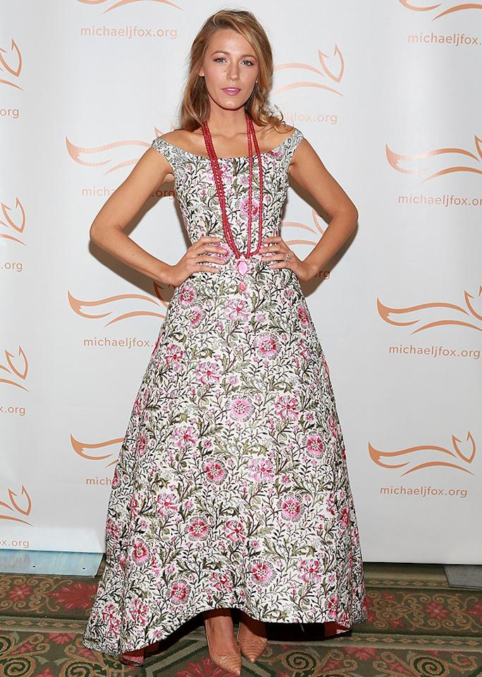 The actresswore an Oscar De La Renta pink and green embroidered floral dress, paired with a long, pink necklace.