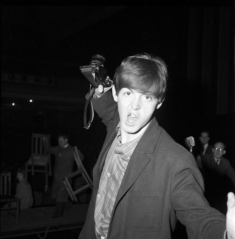 <p>Paul McCartney posing for the camera, with his camera, at the Southend Odeon on December 9, 1963, in Southend-on-Sea, United Kingdom.</p>