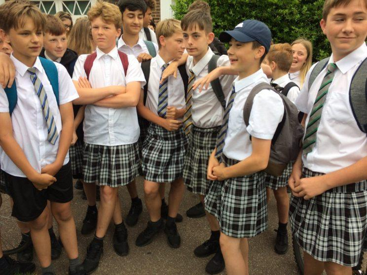 <i>50 Exeter schoolboys have worn skirts in a protest against their school's uniform policy [Photo: Twitter/SimonHallNews]</i>