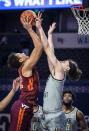 Virginia Tech forward Keve Aluma (22) shoots over defense from Wake Forest forward Ismael Massoud (25) during an NCAA college basketball game Sunday, Jan. 17, 2021, in Winston-Salem, N.C. (Andrew Dye/The Winston-Salem Journal via AP)