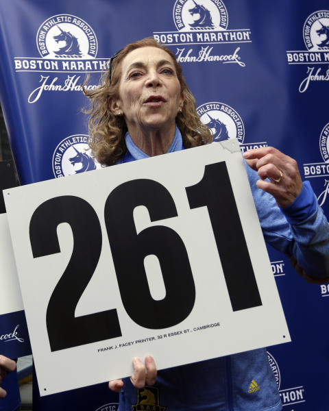 Kathrine Switzer, the first official woman entrant in the Boston Marathon 50 years ago, reacts at a news conference, Tuesday, April 18, 2017, in Boston, where her bib No. 261 was retired in her honor by the Boston Athletic Association. (AP Photo/Elise Amendola)