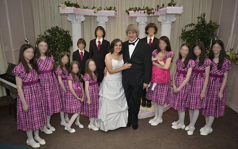 David and Louise Turpin, pictured with their 13 children - Facebook