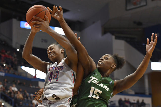 Connecticut's Aubrey Griffin (44) pulls down a rebound over Tulane's Anijah Grant (15) in the first half of an NCAA college basketball game, Wednesday, Feb. 19, 2020, in Hartford, Conn. (AP Photo/Jessica Hill)