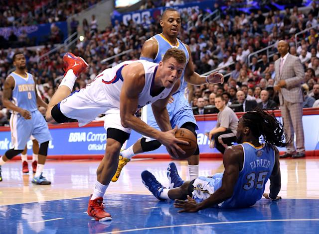 LOS ANGELES, CA - APRIL 15: Blake Griffin #32 of the Los Angeles Clippers is fouled falls after being fouled by Kenneth Faried #35 of the Denver Nuggets at Staples Center on April 15, 2014 in Los Angeles, California. The Clippers won 117-105. NOTE TO USER: User expressly acknowledges and agrees that, by downloading and or using this photograph, User is consenting to the terms and conditions of the Getty Images License Agreement. (Photo by Stephen Dunn/Getty Images)