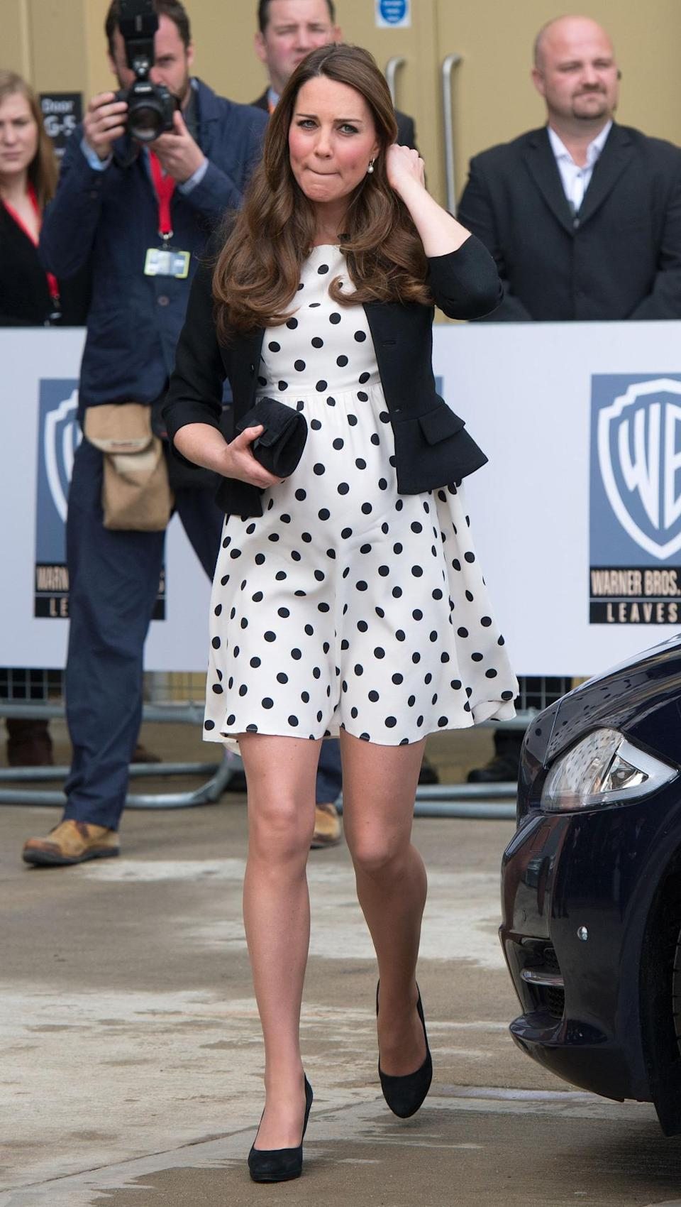 <p>Kate wore a monochrome polka dot dress from Topshop for the Warner Bros Studio Tour. She teamed the outfit with a black jacket, Episode pumps and a suede clutch. </p><p><i>[Photo: PA]</i></p>