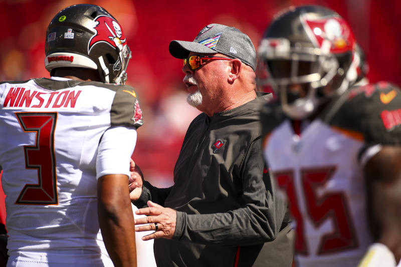 Buccaneers coach Bruce Arians, center, won't commit to Jameis Winston coming back for 2020. (Will Vragovic/Getty Images)