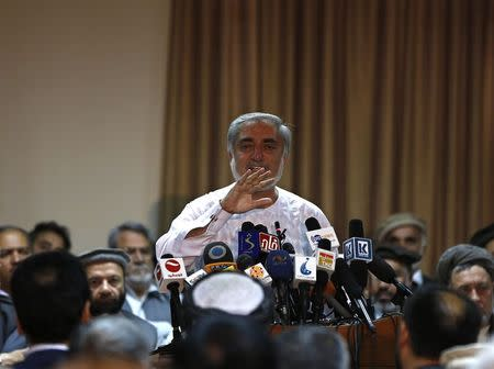 Afghan presidential candidate Abdullah Abdullah speaks during a news conference in Kabul, July 6, 2014. REUTERS/Omar Sobhani