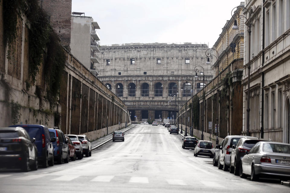 The area around the Colosseum, visible in background, looks deserted, in Rome, Thursday, Dec. 24, 2020. Italy went into a modified nationwide lockdown Thursday for the Christmas and New Year period, with restrictions on personal movement and commercial activity similar to the 10 weeks of hard lockdown Italy imposed from March to May when the country became the epicenter of the outbreak in Europe. (Cecilia Fabiano/LaPresse via AP)