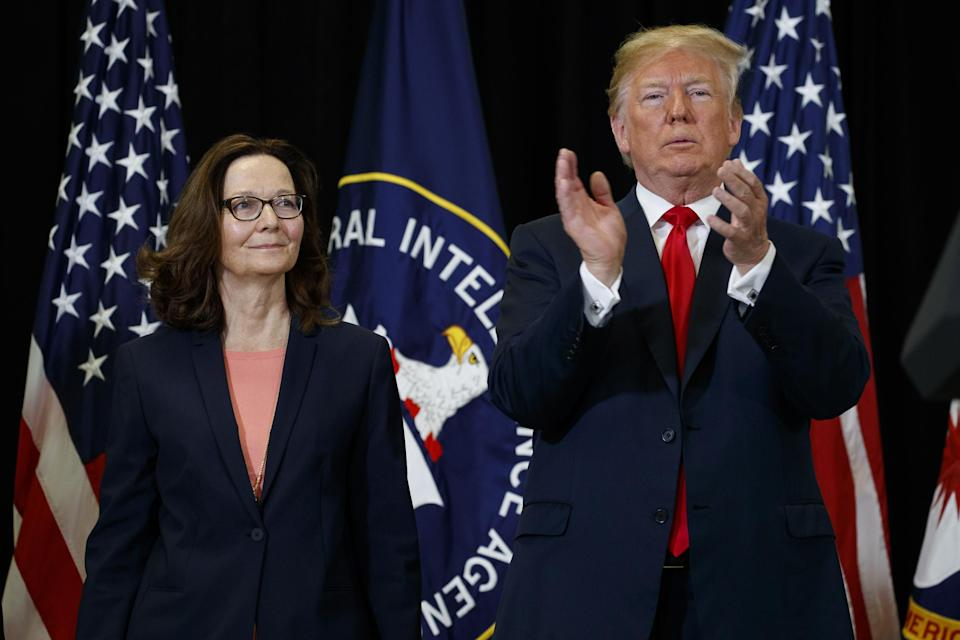 President Donald Trump applauds incoming Central Intelligence Agency director Gina Haspel during a swearing-in ceremony at CIA Headquarters, 21 May 2018, in Langley, Virginia: AP Photo/Evan Vucci