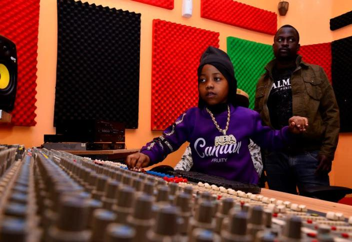 """Ugandan eight-year-old rapper """"Fresh Kid"""", whose real name is Patrick Ssenyonjo, is seen at the Badman Records studios in Kawempe Lugoba, in the outskirts of Kampala"""