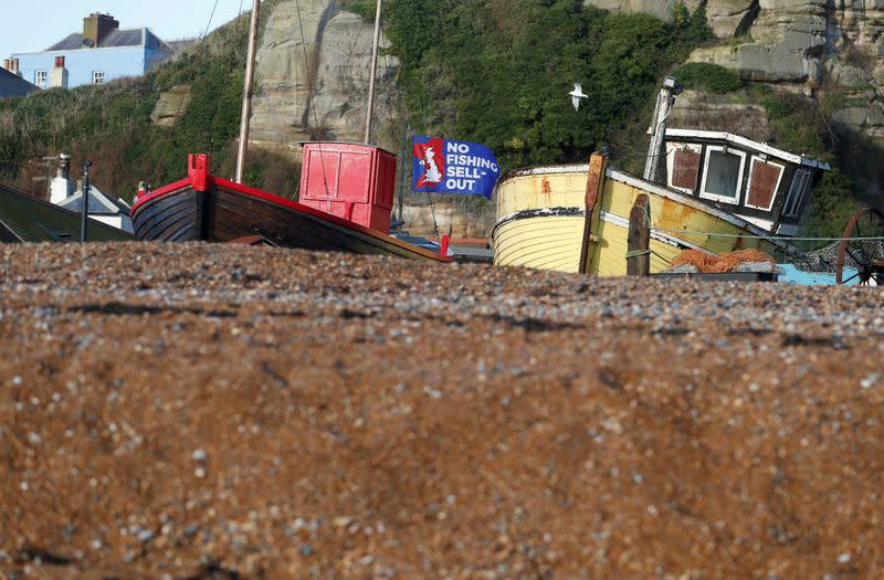 FILE PHOTO: A flag with a slogan supporting the UK fishing industry is seen on the beach in Hastings