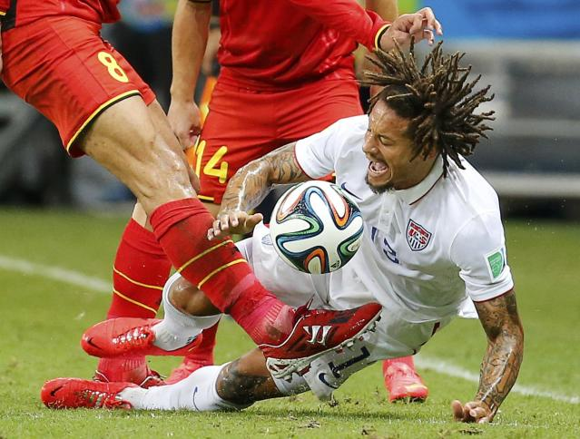 Belgium's Marouane Fellaini kicks the ball near Jermaine Jones of the U.S. during their 2014 World Cup round of 16 game at the Fonte Nova arena in Salvador July 1, 2014. REUTERS/Yves Herman (BRAZIL - Tags: SOCCER SPORT WORLD CUP TPX IMAGES OF THE DAY)
