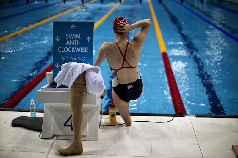Great Britain's Susannah Rodgers adjusts her cap ahead of her Women's  100m Freestyle S7 Final at the 2012 Paralympics Olympics, Monday, Sept. 3, 2012, in London. (AP Photo/Emilio Morenatti)