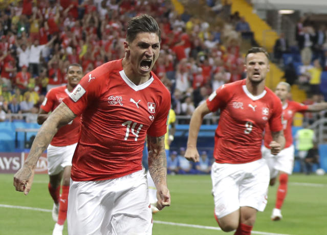 Switzerland's Steven Zuber celebrates with teammates after scoring his side's opening goal during the group E match between Brazil and Switzerland at the 2018 soccer World Cup in the Rostov Arena in Rostov-on-Don, Russia, Sunday, June 17, 2018. (AP Photo/Themba Hadebe)