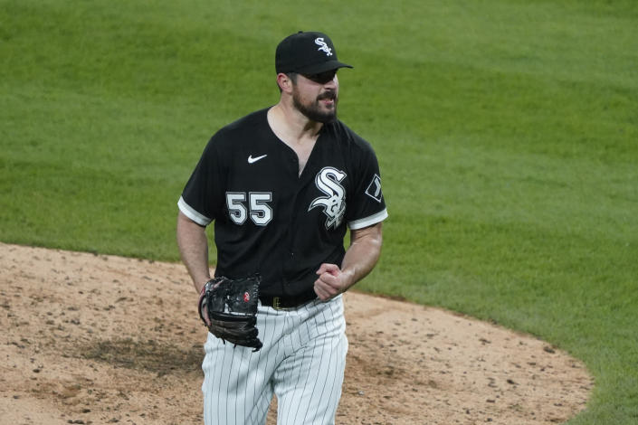 Chicago White Sox starting pitcher Carlos Rodon (55) pumps his fist after striking out Cleveland Indians' Yu Chang (2) to end the sixth inning of a baseball game, Wednesday, April, 14, 2021, in Chicago. (AP Photo/David Banks)