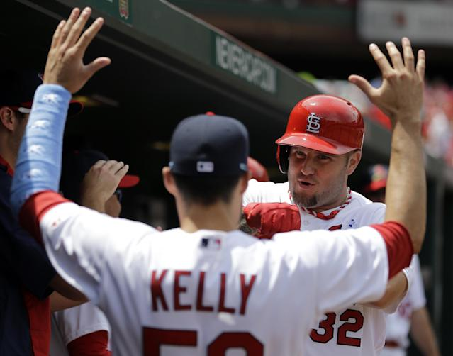St. Louis Cardinals' Matt Adams, right, is congratulated by teammate Joe Kelly after hitting a two-run home run during the second inning of a baseball game against the Washington Nationals, Sunday, June 15, 2014, in St. Louis. (AP Photo/Jeff Roberson)