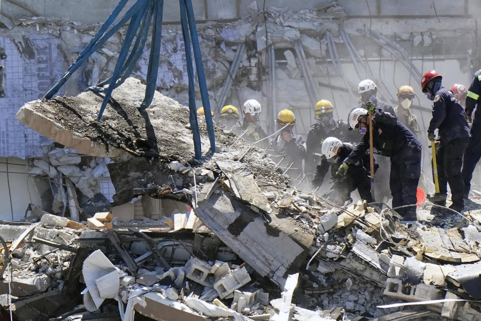 Crews work in the rubble at the Champlain Towers South Condo, Sunday, June 27, 2021, in Surfside, Fla. Many people were still unaccounted for after Thursday's fatal collapse. (AP Photo/Wilfredo Lee)