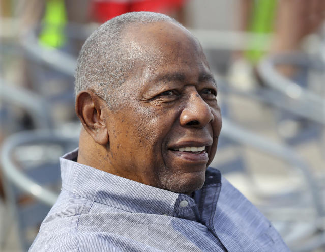 Baseball Hall of Famer Hank Aaron smiles as he is honored with a street named after him outside CoolToday Park, the spring training baseball facility of the Atlanta Braves, in North Port, Fla., Tuesday, Feb. 18, 2020 (Curtis Compton/Atlanta Journal-Constitution via AP)