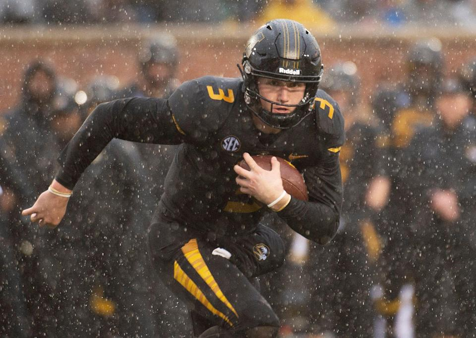 Missouri quarterback Drew Lock runs with the ball against Arkansas (AP Photo)