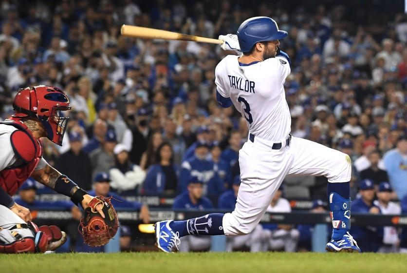 Los Angeles, CA - October 06: Los Angeles Dodgers' Chris Taylor hits the game-winning two-run home run during the ninth inning against the St. Louis Cardinals at Dodger Stadium on Wednesday, Oct. 6, 2021 in Los Angeles, CA. (Wally Skalij / Los Angeles Times)