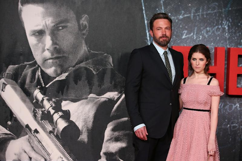 "Anna Kendrick (R) and Ben Affleck pose on the red carpet as they arrive for the European Premiere of the film ""The Accountant"" in London on October 17, 2016"