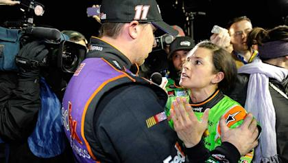An upset Danica Patrick talks with Denny Hamlin about their late accident after the second Budweiser Duel.