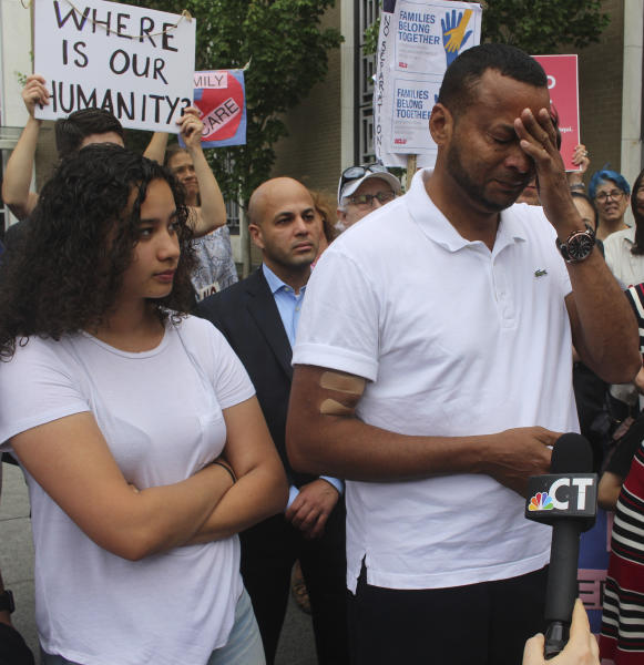 Nelson Rosales Santos, 49, an immigrant who lives in Stamford, Conn., talks to reporters while standing next to his 14-year-old daughter, Samantha, during a rally outside the federal bridling in Hartford, Conn., on Thursday, June 14, 2018. Santos, who suffers from renal failure, received a six-month stay of a deportation order that advocates say would have amounted to a death sentence. (AP Photo/Pat Eaton-Robb)