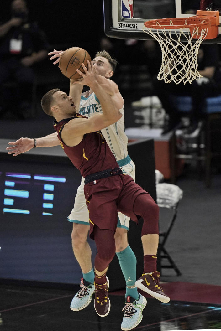 Cleveland Cavaliers' Dylan Windler drives to the basket in the second half of an NBA basketball game against the Charlotte Hornets, Wednesday, Dec. 23, 2020, in Cleveland. Windler broke his left hand on this play in the season opener, another medical setback for a promising player. The team said Thursday that Windler suffered a fourth metacarpal fracture when he took a hard fall in the third quarter against Charlotte. X-rays after the game were negative, but further tests revealed the fracture. (AP Photo/Tony Dejak)