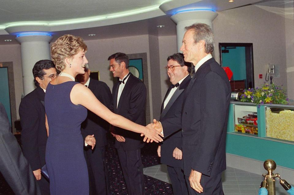 <p>The actor swapped his Western attire for a tuxedo to attend the London premiere of <em>The Fugitive </em>and to meet Princess Diana, of course. </p>