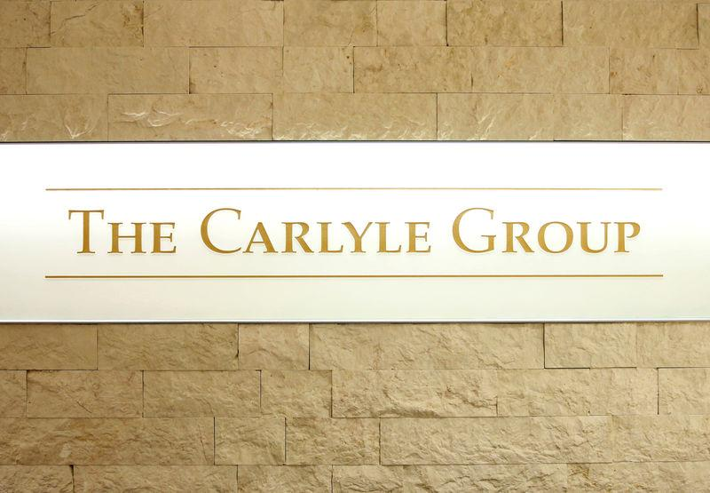 The logo of The Carlyle Group is displayed at the company's office in Tokyo