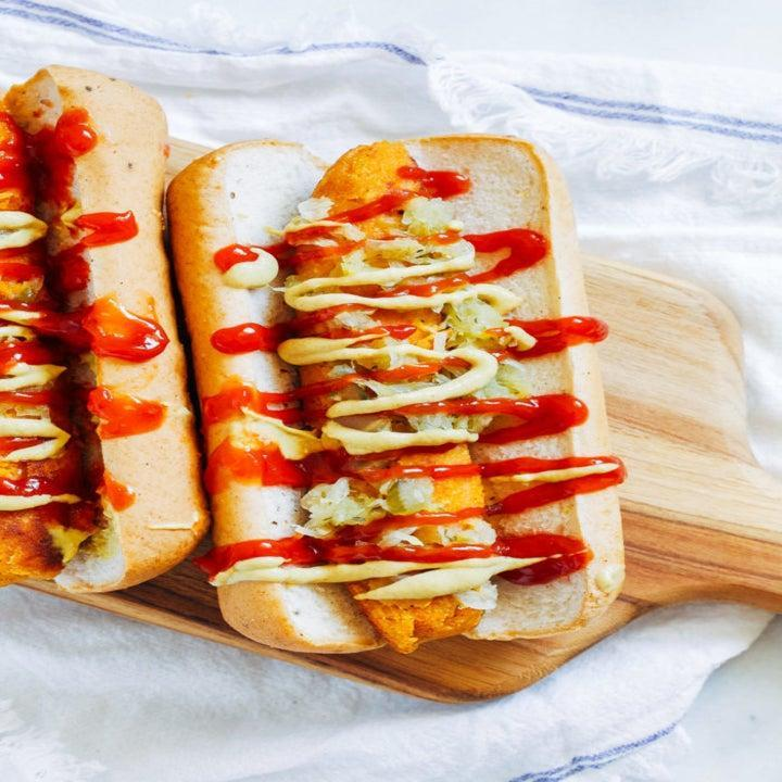 Hot dogs in a bun with ketchup, mustard, and relish
