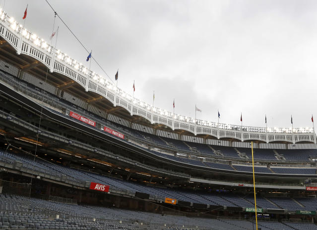 Rain clouds gather over Yankee Stadium after a baseball game between the New York Yankees and the Baltimore Orioles was postponed due to inclement weather, Tuesday, May 14, 2019, in New York. This follows the postponement of Monday's game between the two teams due to unplayable field conditions from excess rainwater pooling in the outfield. (AP Photo/Kathy Willens)