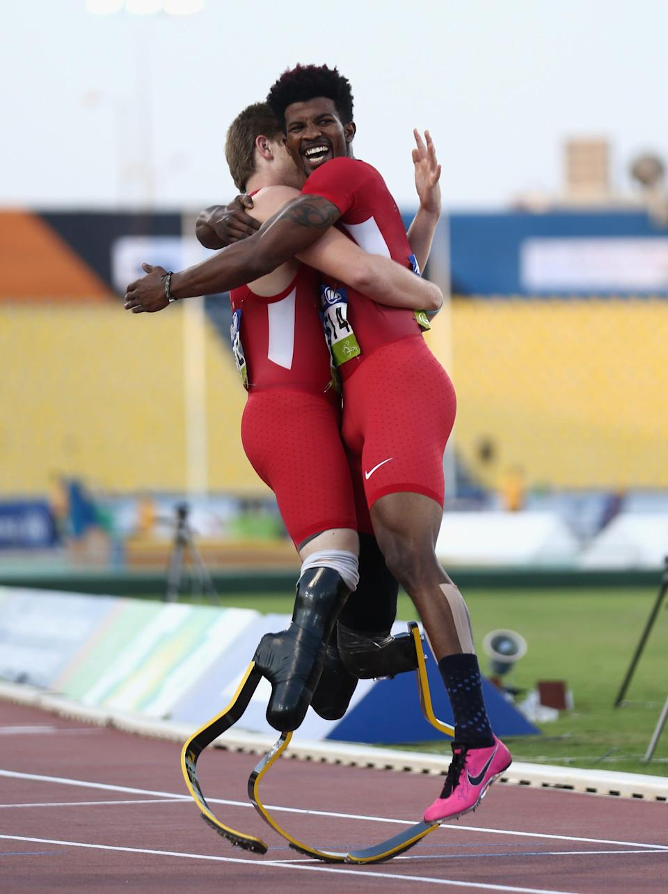 Richard Browne, right, of the United States celebrates winning the men's 200m T44 final with teammate Hunter Woodhall during the IPC Athletics World Championships in 2015 in Doha, Qatar.