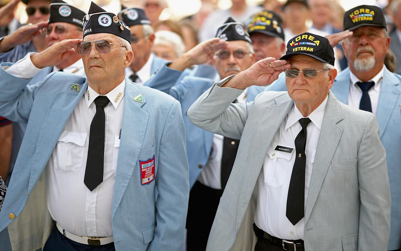Veterans of the Korean War salute during the commemoration of the 59th anniversary of the Korean War Armistice at Arlington National Cemetery July 27, 2012 in Arlington, Virginia. Hundredes of Korean war veterans attended the cemmemoration of the armistice agreement that ended more than three years of fighting between the United Nations, the People's Republic of China, North Korea and South Korea.  (Photo by Chip Somodevilla/Getty Images)