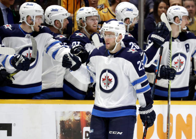 Winnipeg Jets center Paul Stastny (25) is congratulated after scoring a goal against the Winnipeg Jets during the second period in Game 1 of an NHL hockey second-round playoff series Friday, April 27, 2018, in Nashville, Tenn. (AP Photo/Mark Humphrey)