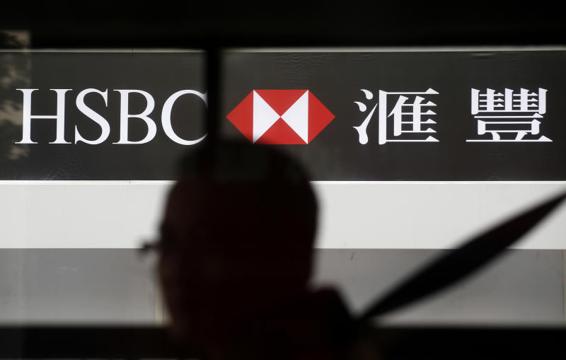 A man walks past the HSBC's Hong Kong headquarters in central district of Hong Kong Monday, March 4, 2013. The HSBC banking group said Monday its net profit dropped 17 percent in 2012, when it had to pay a hefty U.S. fine to settle money-laundering claims. But earnings remained robust at US$13.5 billion as Asian businesses performed well. (AP Photo/Vincent Yu)