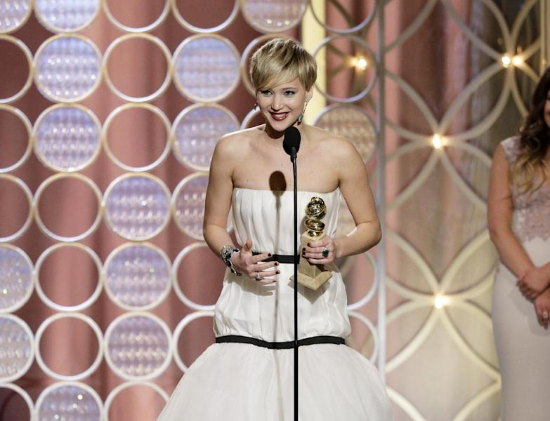 "This image released by NBC shows Jennifer Lawrence, left, accepting the award for best supporting actress in a motion picture for her role in ""American Hustle,"" during the 71st annual Golden Globe Awards at the Beverly Hilton Hotel on Sunday, Jan. 12, 2014, in Beverly Hills, Calif. (AP Photo/NBC, Paul Drinkwater)"
