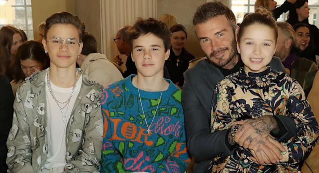 Harper Beckham dishes more style inspiration in NHS t-shirt and Adidas sliders. (Getty Images)