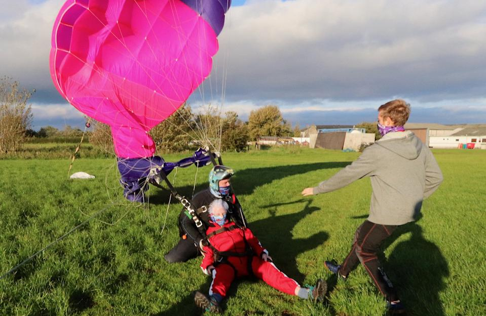 """A thrill seeking great-gran has celebrated her 90th birthday - by taking to the air and SKYDIVING from 15,000 feet. Sprightly Patricia Baker said it felt """"awesome"""" to plunge from a whopping three miles up in testing conditions. Brilliant photos and videos show the widowed gran-of-ten dressed in a red jumpsuit flying through the sky. Patricia said she """"wasn't too worried"""" about the jump because she """"keeps herself fit"""" by doing 50 sit ups every morning. And her main motivation was to raise some money for charity, she added."""