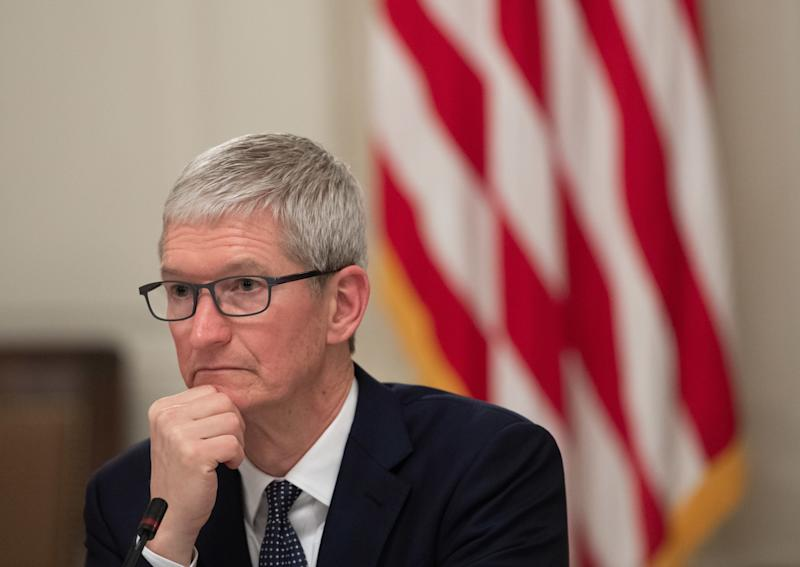 Apple CEO Tim Cook attends the first meeting of the American Workforce Policy Advisory Board with US President Donald Trump in the State Dining Room of the White House in Washington, DC, March 6, 2019. (Photo by SAUL LOEB / AFP) (Photo credit should read SAUL LOEB/AFP/Getty Images)