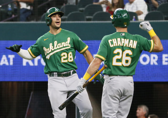 Oakland Athletics' Matt Olson prepares to body bump Matt Chapman after hitting his second solo home run of the game against the Texas Rangers during the sixth inning of a baseball game in Arlington, Texas, Sunday, July 11, 2021. (AP Photo/Ray Carlin)