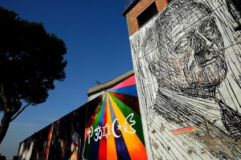 A painting on a wall of the Metropoliz Museum of the Other and the Elsewhere (MAAM) which is also home to 200 squatters, including Roma and people from all corners of the globe, in Rome, on November 25, 2014